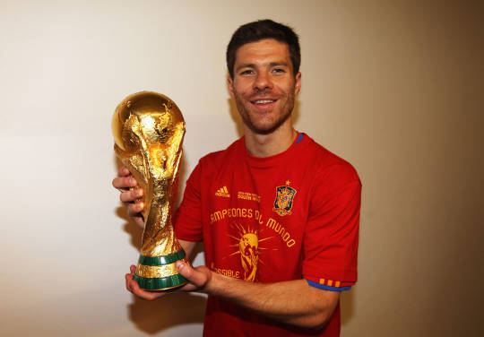 2010 FIFA World Cup: Midfielder Alonso Xavi Poses with World Cup Trophy during the 2010 FIFA World Cup South Africa Final match between Netherlands and Spain at Soccer City Stadium on July 11, 2010 in Johannesburg, South Africa