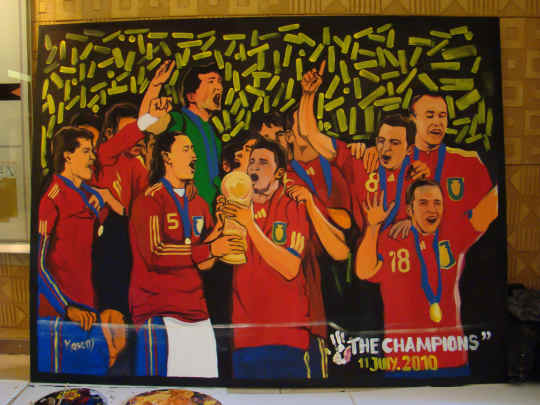 2010 FIFA World Cup: 'The Champions' Painting by Paul Junior Kasemwana during the 2010 FIFA World Cup South Africa Final match between Netherlands and Spain at Soccer City Stadium on July 11, 2010 in Johannesburg, South Africa