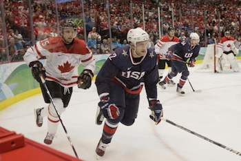 2010 Vancouver Winter Olympic Games: Men's Hockey - Canada Claims Gold with 3-2 OT Victory over U.S. 2010 WINTER OLYMPIC GAMES -- Men's Hockey Gold Medal Game - USA versus Canada -- Pictured: (l-r) Dany Heatley of Canada, Ryan Malone of Team USA -- Photo by: Paul Drinkwater/NBC