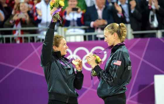 Misty May-Treanor and Kerri Walsh during their golden moment after winning their third straight Olympic gold medal
