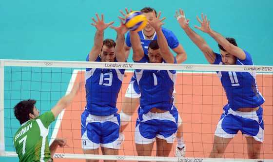 Italy's Dragan Travica, Luigi Mastrangelo and Cristian Savani put up a triple block against Bulgaria