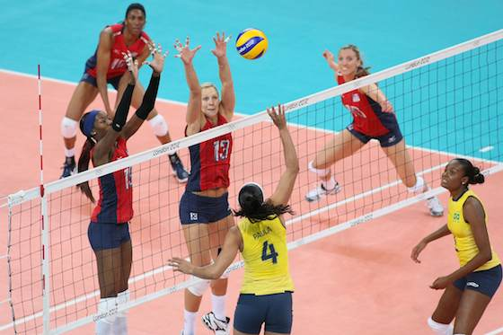 Paula Pequeno of Brazil being confronted with the US double block of Destinee Hooker and Christa Harmotto in a preliminary match that ended in a 1-3 defeat for the South Americans