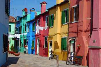 Pastel houses line the streets of Burano, an island in Venice's lagoon.