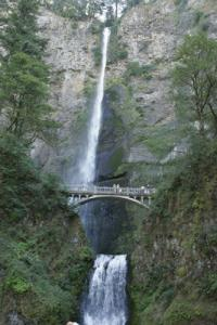 Multnomah Falls, Oregon's top natural attraction. A picturesque stone bridge spans it. Exploring the Pacific Northwest Seattle, Washington State's National Parks & the Oregon Coast - Cindy Ross World's Fare