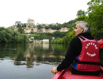Canoeists get a dramatic view of the French village of Beynac as it tumbles down a steep hill from its majestic castle to the Dordogne River
