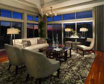 Furniture pulled away from the walls and arranged in an open U-shape or conversationally makes your home feel more spacious and more appealing to buyers