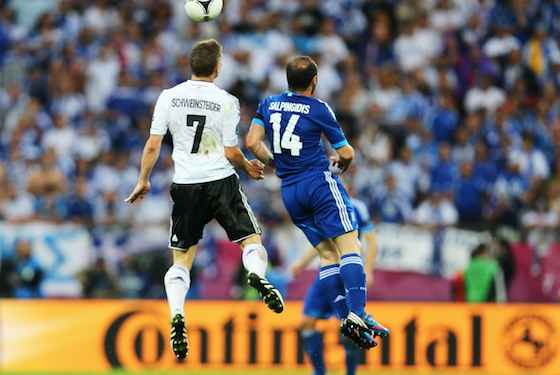 Bastian Schweinsteiger of Germany and Dimitris Salpigidis of Greece jump for the ball (Photo by Joern Pollex/Getty Images)