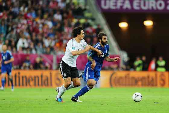 Sami Khedira of Germany and Grigoris Makos of Greece battle for the ball (Photo by Joern Pollex/Getty Images)