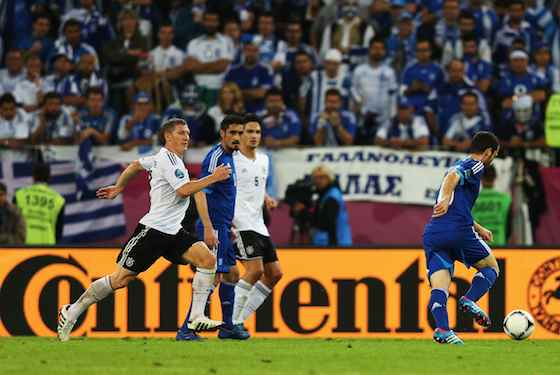 Bastian Schweinsteiger of Germany closes down Giorgos Fotakis of Greece (Photo by Joern Pollex/Getty Images)