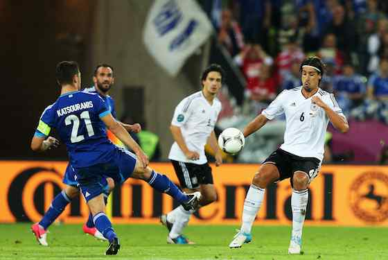 Kostas Katsouranis of Greece and Sami Khedira of Germany battle for the ball (Photo by Joern Pollex/Getty Images)