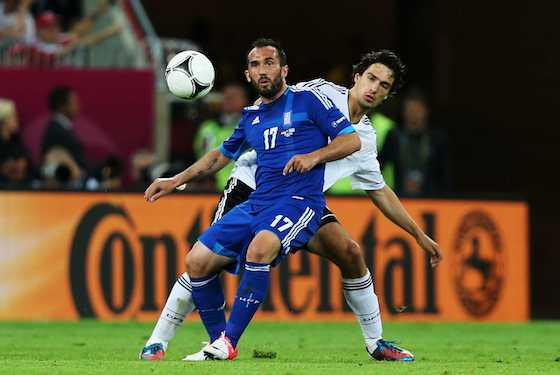 Theofanis Gekas of Greece and Mats Hummels of Germany tussle for the ball (Photo by Joern Pollex/Getty Images)