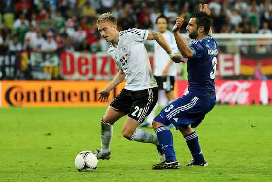 Marco Reus of Germany and Giorgos Tzavelas of Greece tussle for the ball (Photo by Alex Grimm/Getty Images)