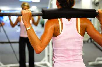 Balancing barbell across your shoulders while doing squats, lunges, or walking lunges helps develop posture and balance