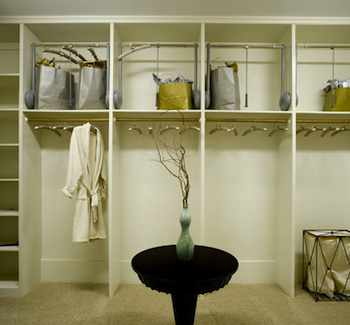Although the area closest to your ceiling is hard to get to, it's still a great place to store items you don't use often. Installing pull down closet rods up high will store seasonal clothes but still leave them in easy reach