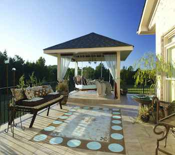 The striking pergola adds a wow factor to this patio, as well as providing a comfortable spot to relax