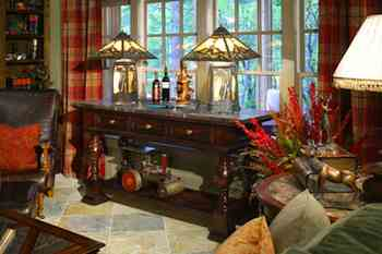 As the season changes from summer to fall, country style becomes more appealing. Jewel and fall tones, as well as plaid and paisley patterns, set the design tempo of this country casual room