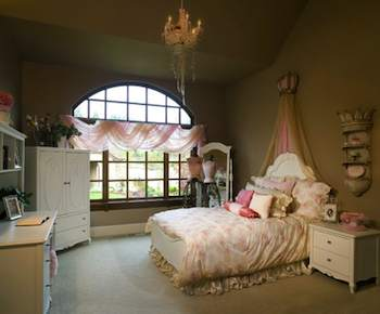 This bedroom would make any little girl feel like a princess in her castle, complete with crystal chandelier
