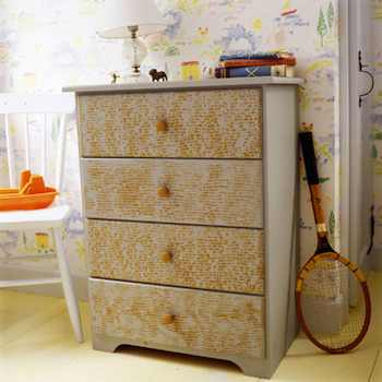 The interesting pattern on the front of this dresser was created by using a corncob as a paint roller