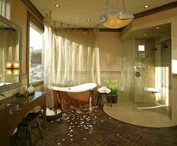 The difference between a mere bath and the ultimate home spa is atmosphere. Like a