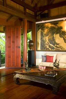 Pan-Asian style is becoming a popular choice again for interior decorating. The style incorporates natural elements, handmade artwork and handcrafts. This room blends Thai accessories with a Chinese painted screen