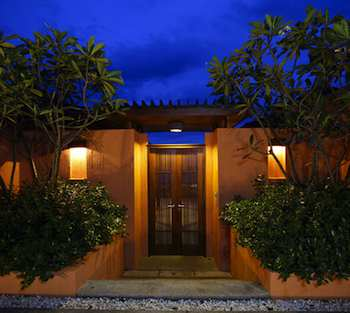 Exterior Lighting Makes Home More Appealing and Safer - CaptionGood lighting sets a mood, creates a special feeling and turns a home into a haven. This entry has both side and top lighting that makes the home more welcoming and safer by illuminating whoever is standing at the door