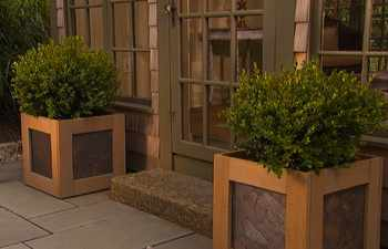These handsome planters, made of cedar with a slate inlay, are able to winter in cold climates without damage