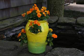 Strawberry jars are great for growing just about any plant that thrives in well-drained soil. This one is planted with violas