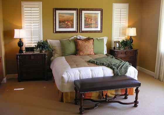 Wood shutters shut out light and can also block both cold and heat, making them a good choice for winter and summer