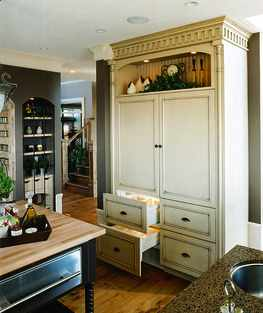 Kitchen Cabinets that Conceal Appliances - Cabinetry that conceals appliances, such as the refrigerator, creates a very distinctive look in the kitchen, making it look more livable and less focused on function