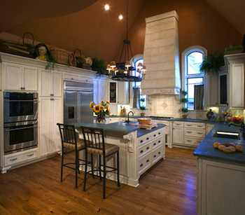 Kitchen Hoods Take Center Stage - Today's range hoods are now a focal point of the kitchen in addition to serving the important function of venting the stove.