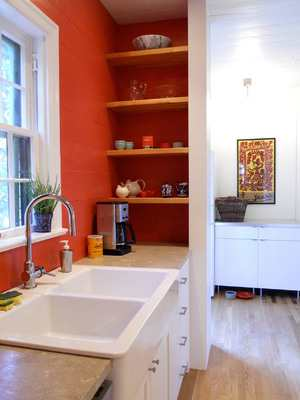 Eclectic choices of colors and fixtures -- natural and painted wood, marble and wood countertops, open shelves and more conventional cabinets -- make a kitchen more interesting