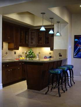 Outfitting a home bar isn't difficult and your efforts are sure to be more appreciated -- and enjoyed -- than another tie!