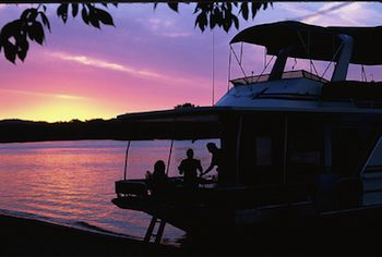 Houseboating on the Mississippi River - The setting sun reflects off the Mississippi turning the water pink