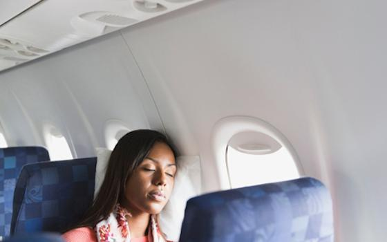 How to Catch Some Zzzzs on Your Next Flight