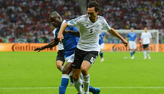 WARSAW, POLAND - JUNE 28: Mario Balotelli (L) of Italy and Mats Hummels of Germany in action during the UEFA EURO 2012 semi final match between Germany and Italy at the National Stadium on June 28, 2012 in Warsaw, Poland. (Photo by Shaun Botterill/Getty Images)