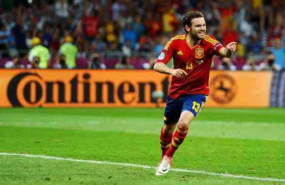 KIEV, UKRAINE - JULY 01: Juan Mata of Spain celebrates after scoring his team's fourth goal during the UEFA EURO 2012 final match between Spain and Italy at the Olympic Stadium on July 1, 2012 in Kiev, Ukraine (Photo by Laurence Griffiths/Getty Images)