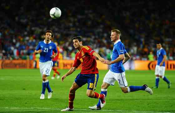 KIEV, UKRAINE - JULY 01: Cesc Fabregas of Spain in action against Ignazio Abate of Italy during the UEFA EURO 2012 final match between Spain and Italy at the Olympic Stadium on July 1, 2012 in Kiev, Ukraine (Photo by Laurence Griffiths/Getty Images)