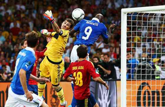 KIEV, UKRAINE - JULY 01: Iker Casillas of Spain stretches for the ball as Mario Balotelli of Italy jumps to head at goal during the UEFA EURO 2012 final match between Spain and Italy at the Olympic Stadium on July 1, 2012 in Kiev, Ukraine (Photo by Alex Grimm/Getty Images)
