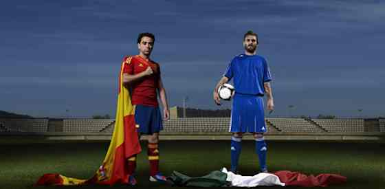 Euro 2012 Finals Preview: Italy vs Spain - Xavi Hernadez of Spain head to head against Daniele De Rossi of Italy (Source: Adidas)