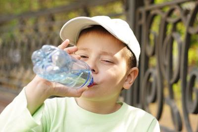 When playing outdoors, make sure your child has a full bottle of cool water and encourage him to occasionally take a break and have a sip.