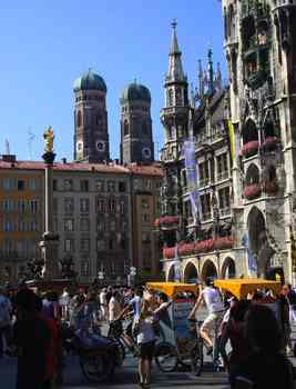 The twin green domes of Munich's Frauenkirche overlook the city's bustling main square, Marienplatz