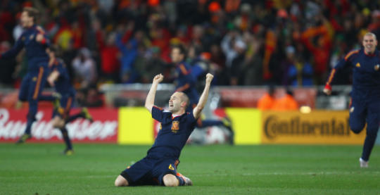 Andres Iniesta of Spain celebrates after his goal wins the 2010 FIFA World Cup for Spain against the Netherlands
