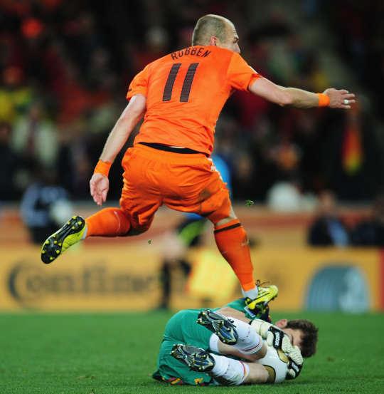 Spain's Goalkeeper Iker Casillas saves Netherlands' Arjen Robben shot