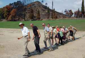 Visitors in ancient Olympia line up at the original starting block for the first Olympics