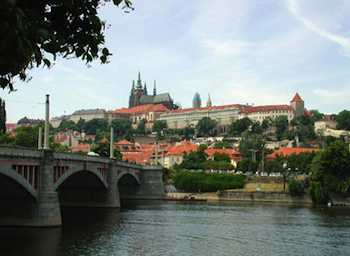 Prague: Castle Scenes and Ice Cream Dreams - Regally perched on a hill above town, Prague Castle is surrounded by a church, cathedral, and several palaces built by nobles who competed with the Church for influence on the king