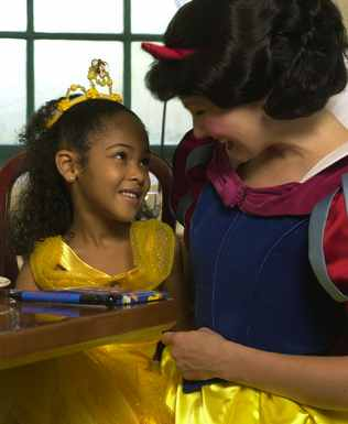 Snow White and a princess-in-training enjoy breakfast together.