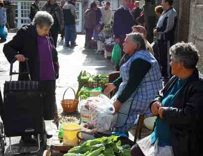 Farmers markets, like this one in Santiago, are fundamental to European life.