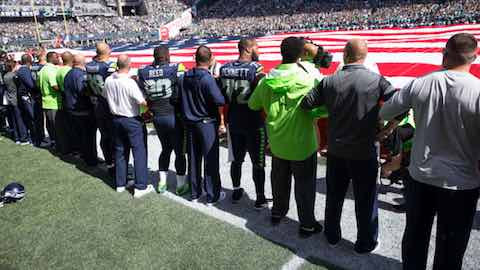 Seahawks players, coaches and staffers locked arms during the national anthem as a gesture of unity. (Drew McKenzie, Sportspress Northwest)