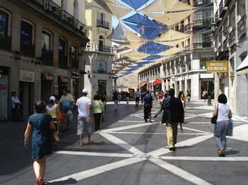 Car-free streets in Madrid, such as the Calle del Carmen, helped turn worn-out areas into trendy zones