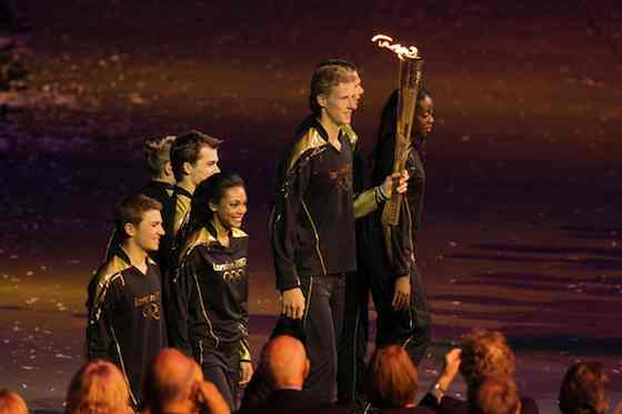 2012 Summer Olympics: Opening Ceremony - Young athletes carry the Olympic flame (Photo by: Paul Drinkwater/NBC)